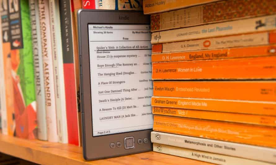 An Amazon Kindle on a bookshelf