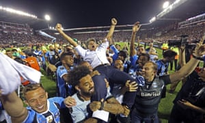 Brazil's Gremio soccer players carry their coach Renato Gaucho after winning the Copa Libertadores championship following their game against Argentina's Lanus in Buenos Aires, Argentina, 29 November 2017.