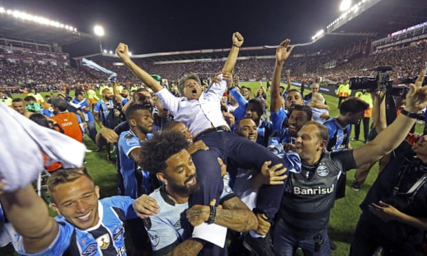 Brazil's Gremio soccer players carry their coach Renato Gaucho after winning the 2017 Copa Libertadores championship following their game against Argentina's Lanus in Buenos Aires