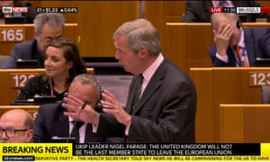 Vytenis Andriukaitis (top right) reacts to Nigel Farage's speech.