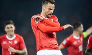 Switzerland's Haris Seferovic celebrates his hat-trick against Belgium.