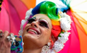 A drag queen takes part in the parade