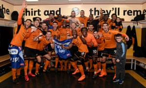 Wolves players celebrate promotion after beating Birmingham City at Molineux.
