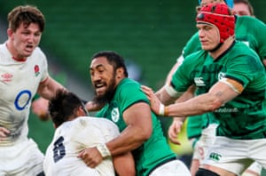 England's Billy Vunipola is tackled by Bundee Aki of Ireland.