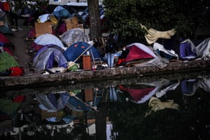 Paris, France Asylum seekers gather their belongings ahead of their evacuation from a makeshift camp set along the canal Saint-Denis in Aubervilliers in the north-eastern suburbs of Paris