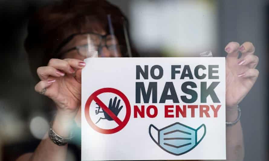 Face masks sign on shop