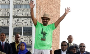 Abiy Ahmed waves to supporters at the rally