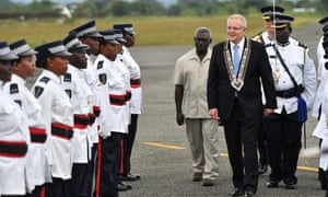 Australian prime minister Scott Morrison and Solomon Islands prime minister Manasseh Sogavare inspect an honour guard after arriving at Honiara international airport.