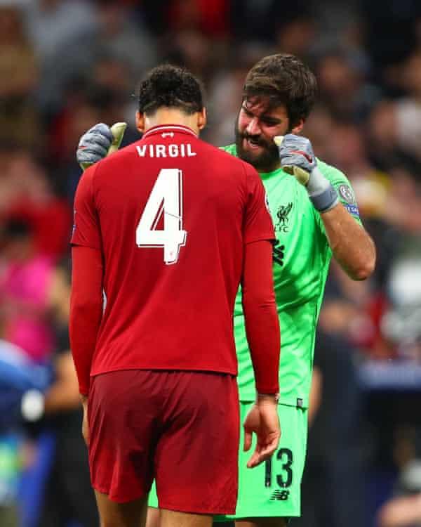 Alisson celebrates with Virgil van Dijk at the end of the UEFA Champions League final against Tottenham at Estadio Wanda Metropolitano on 1 June 2019.