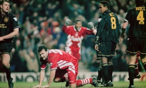 Neil Ruddock heads in Liverpool's third goal as they came back from 3-0 down to earn a draw at Anfield in 1994.