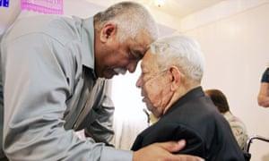 Family member hugging Guadalupe Cuevas at his living wae in Alternate Endings