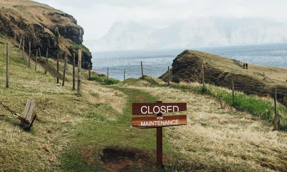 Sign reading CLOSED FOR MAINTENANCE PROJECT, Faroe Islands. The Faroe Islands' 'Closed for Maintenance' project is part tourism initiative, part conservation plan.