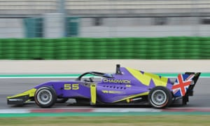 A purple racing car with green markings and 'Chadwick' written on the side, on a race track