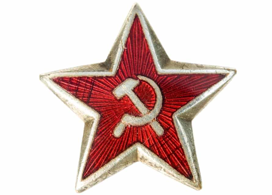 Old communist star with sickle and hammer isolated on a white background