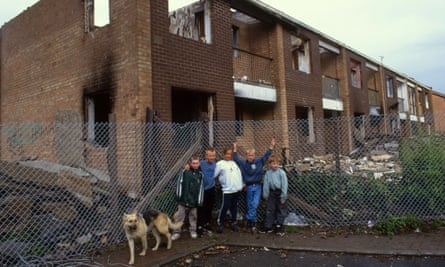 Children near derelict houses on a housing estate in Collyhurst, Manchester.