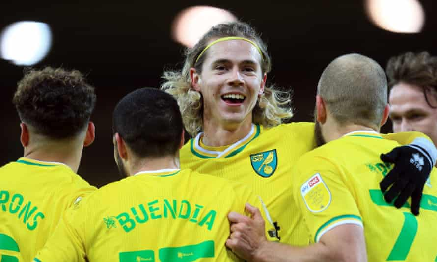 Todd Cantwell celebrates with three other key Norwich players this season, Max Aarons, Emi Buendía and Teemu Pukki, after Buendía scored in this month's 7-0 win against Huddersfield.