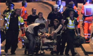 Police and members of the emergency services attend to victims of a terror attack on London Bridge.