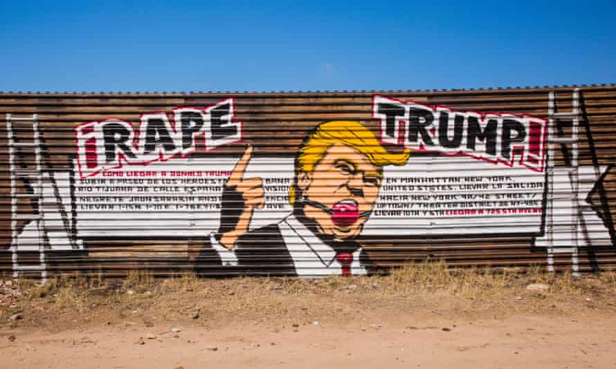 "Donald Trump art images Rape Trump by the art collective, Indecline Street artist Indecline painted a mural one mile west of Tijuana airport on the old border wall, between Mexico and America. ""¡Rape Trump!"" showed the presidential candidate's face is shown with a red ball gag in his mouth. The mural also includes instructions in Spanish (with grammatical errors) describing how to get to Trump Tower in New York City"