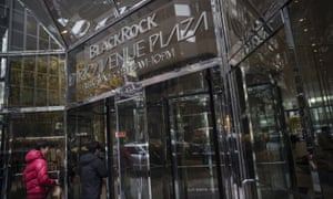 People enter BlackRock Inc headquarters in New York.