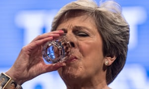 Theresa May pauses to drink a glass of water during her speech
