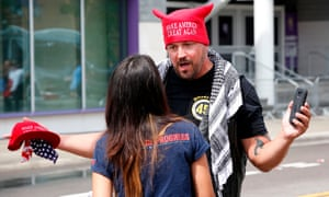A Trump supporter faces off with a protester near the Amway Center.