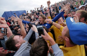 Team Europe's Tommy Fleetwood celebrates with spectators after Europe win the Ryder Cup