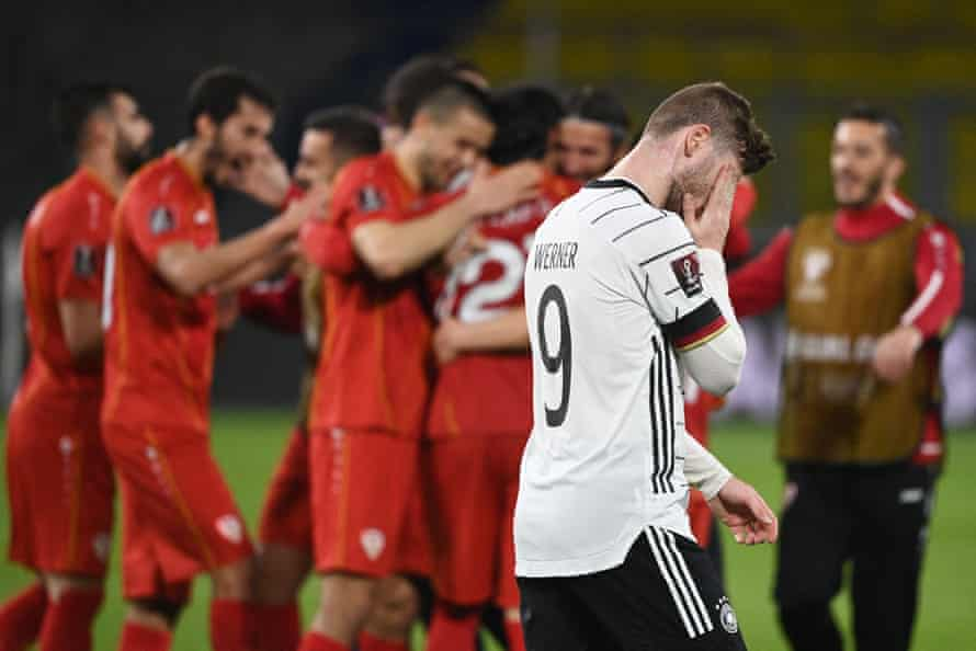 North Macedonia players celebrate as Germany's forward Timo Werner despairs.