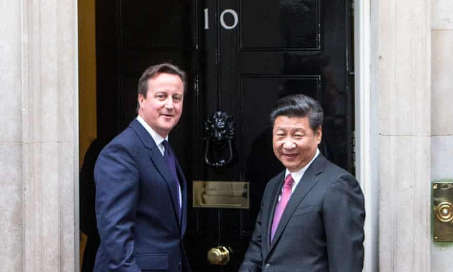 David Cameron greets Chinese president Xi Jinping at Downing Street in London.