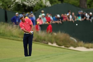 Rickie Fowler plays a shot on the sixth green.