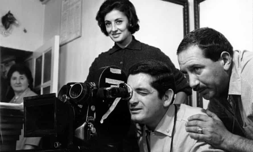 Jean Rabier, right, with Jacques Demy, centre, setting up a shot during filming of The Umbrellas of Cherbourg.