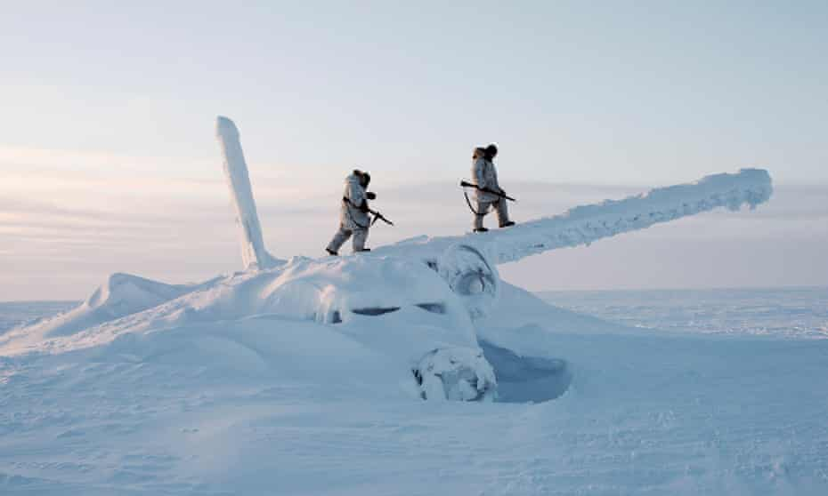 Canadian Arctic Operations Advisors scale the decades-old wreckage of an airplane in temperatures below minus 50 degrees Celsius. They are on reconnaissance outside Resolute Bay on Cornwallis Island, Nunavut, Canada.