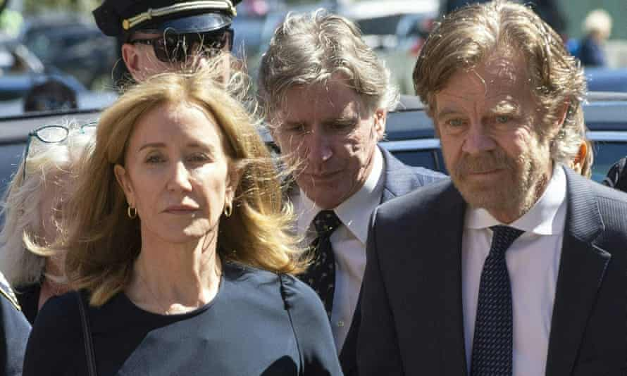 Felicity Huffman, escorted by her husband William H Macy, arrives in court in Boston.