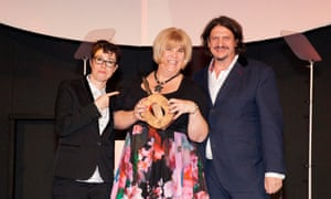 Kerry Teakle picks up her Best Readers' Recipe award from Sue Perkins and Jay Rayner for her whisky, orange and almond cake recipe