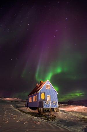 On our second night in the Inuit village of Oqaatsut (formerly Rodebay), West Greenland, we were treated to a display of the dancing green lights of an aurora illuminating this pretty blue house. An unforgettable experience.