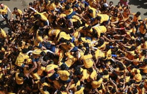 Mumbai, India An attempted human pyramid collapses during celebrations to mark the Janmashtami festival.