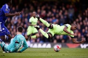Fernandinho goes flying and Courtois is sent off.