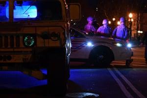 National Guardsmen sit on a police car at a junction