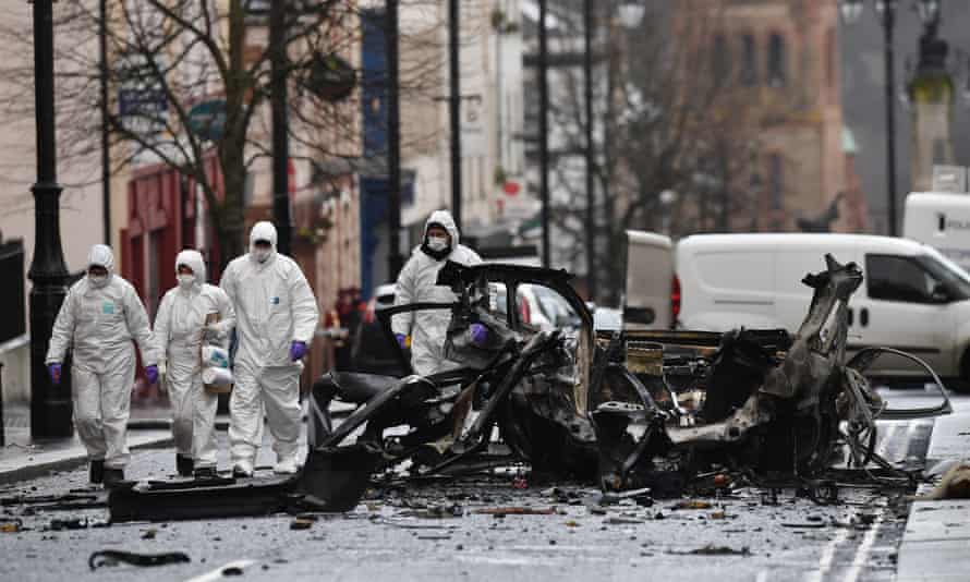 Forensic officers inspect the remains of a New IRA car bomb outside Derry court house in 2019.