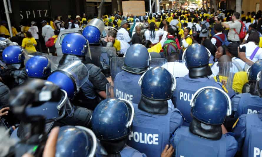 South African police riot squad clash with ANC supporters.