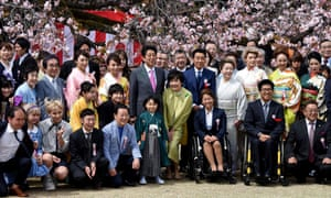 Shinzo Abe and his wife, Akie, with guests during the annual cherry blossom viewing party hosted by the prime minister in Tokyo.