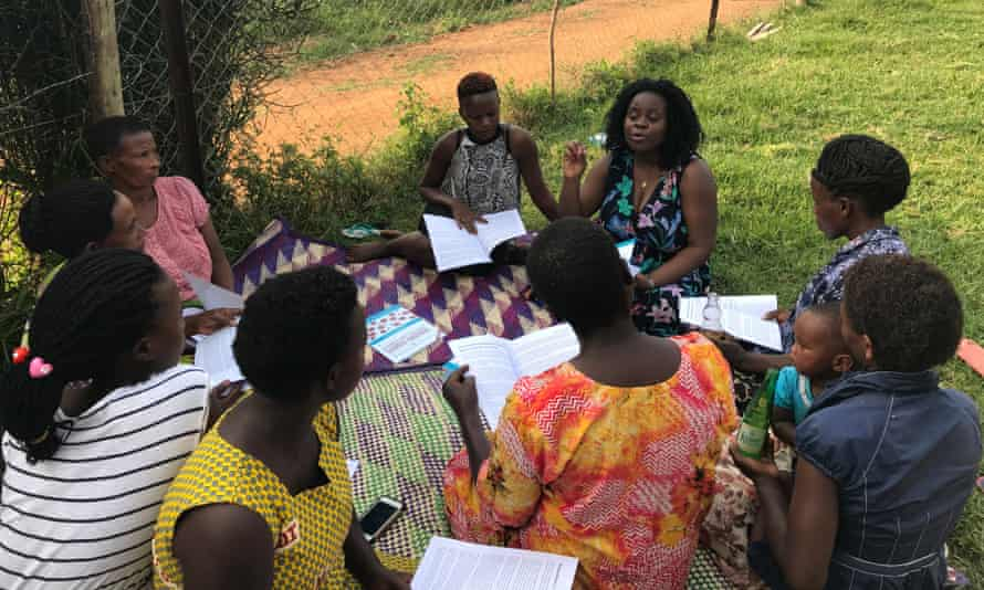 Diana Namumbejja Abwoye with a women's group in Uganda, discussing Our Bodies, Ourselves
