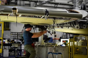 A man works on a C Series aeroplane wing in the Bombardier factory in Belfast, Northern Ireland.