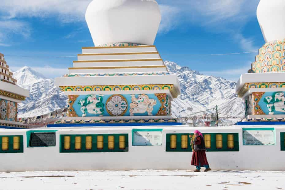 A lone figure walks in front of a Buddhist temple in Leh.