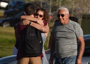 Students are reunited with their parents outside Marjory Stoneman Douglas high school.