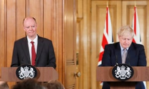 Chris Whitty, left, stands beside Boris Johnson as the prime minister outlines the UK's strategy for dealing with the coronavirus outbreak on Tuesday.