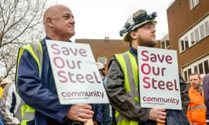 Workers wait to confront the business secretary, Sajid Javid, as he leaves Tata Steel in Port Talbot.