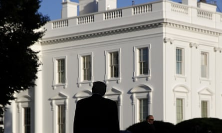Donald Trump in silhouette against the White House