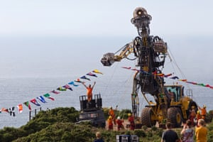 Giant metal man sculpture in a field near the coast. The Man Engine Resurrection Tour.