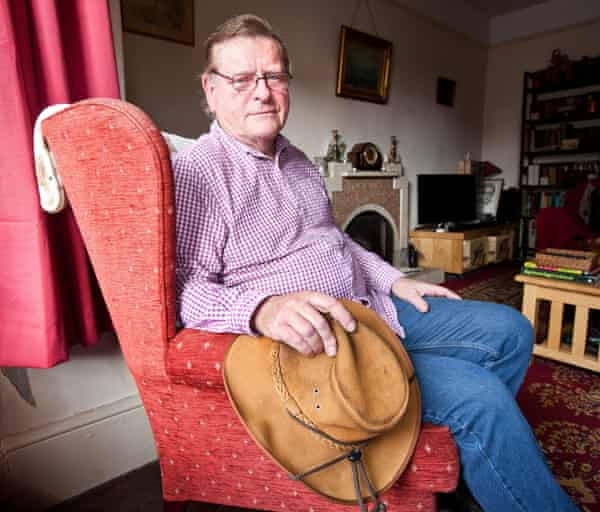 Roger Lilley sits in an armchair at his home.