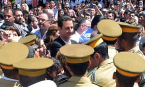 President Bashar al-Assad during an appearance at a school in the capital Damascus on Syria's Martyrs Day